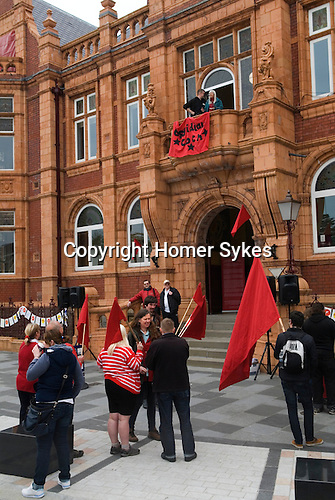 Made In Spring. Walkers gather at Redhouse in Merthyr to hear visual artist Iwan Bala's speech before setting off. May 2014