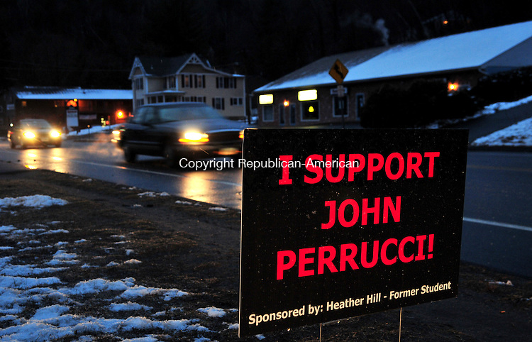 THOMASTON, CT 02 MAR 12 - 02_NEW030112AJ01 -  Signs in support of Thomaston High School Principal John Perrucci were posted in lawns around town.  Alec Johnson / Republican-American..