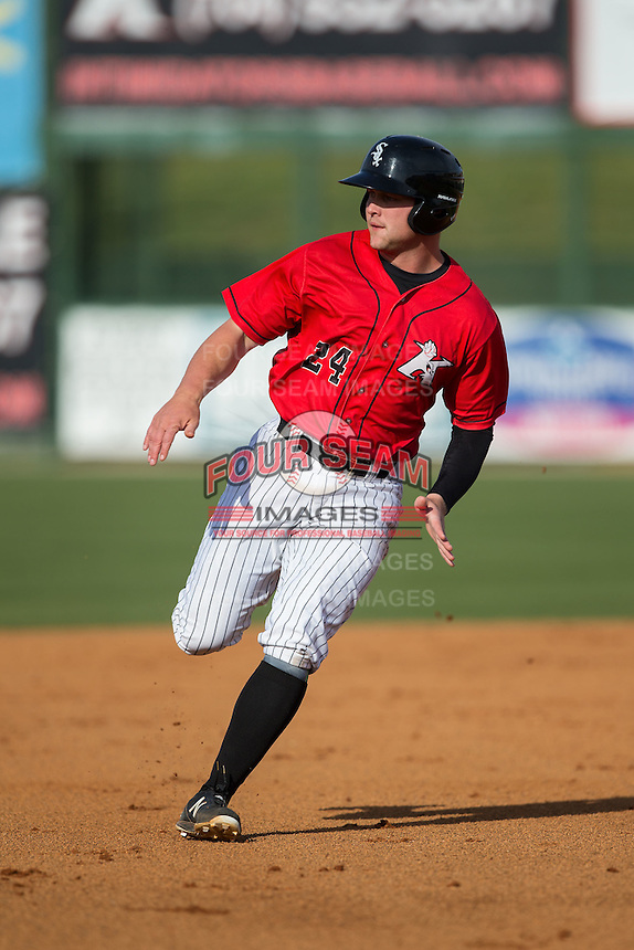 Zach Fish (24) of the Kannapolis Intimidators keeps an eye on the ball in left field as he hustles towards third base against the Hickory Crawdads at Kannapolis Intimidators Stadium on April 10, 2016 in Kannapolis, North Carolina.  The Intimidators defeated the Crawdads 10-3.  (Brian Westerholt/Four Seam Images)