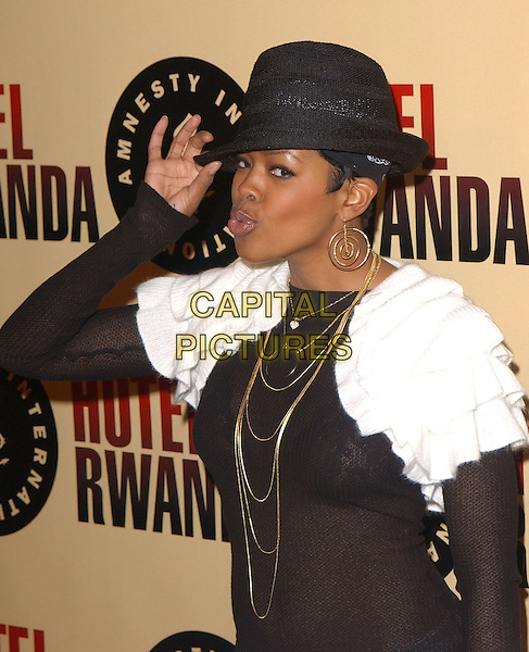 "MALINDA WILLIAMS.Los Angeles Premiere of ""Hotel Rwanda"" held at The Academy Theatre in Beverly Hills, California.December 2nd, 2004.half length, gold necklaces, hat, touching rim of hat, gesture, white ruffle cape, collar, black top, see through, see thru, gold hoop earrings.www.capitalpictures.com.sales@capitalpictures.com.Supplied by Capital Pictures."