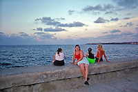 Hanging out on the Malecon Havana Cuba, Republic of Cuba,