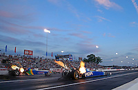 May 31, 2013; Englishtown, NJ, USA: NHRA top fuel dragster driver T.J. Zizzo (right) races alongside Sidnei Frigo during qualifying for the Summer Nationals at Raceway Park. Mandatory Credit: Mark J. Rebilas-
