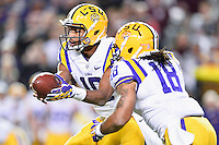 LSU quarterback Anthony Jennings (10) handoff to running back Terrence Magee (18) during an NCAA football game, Thursday, November 27, 2014 in College Station, Tex. LSU defeated Texas A&M 23-17. (Mo Khursheed/TFV Media via AP Images)