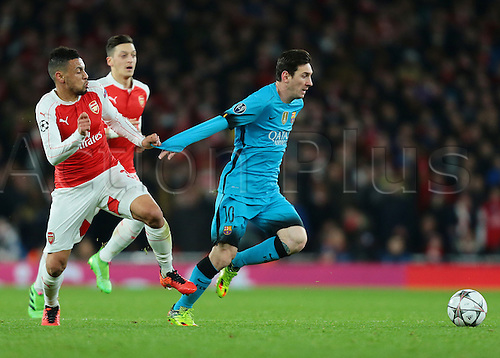 23.02.2016. Emirates Stadium, London, England. UEFA Champions League. Arsenal versus Barcelona. Barcelona Midfielder Lionel Messi is awarded a free kick after Arsenal Midfielder Francis Coquelin pulls him down by his sleeve