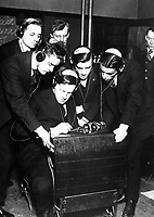Government preparing men for radio work under direction of Federal Vocational Board.  Student transmitting a message to four of his classmates in the class room at the Stuyvesant Evening High School, N.Y.  April 1918.  Ca.  1918.  Western Newspaper Union.  (War Dept.)<br />Exact Date Shot Unknown<br />NARA FILE #:  165-WW-113A-5<br />WAR & CONFLICT BOOK #:  445