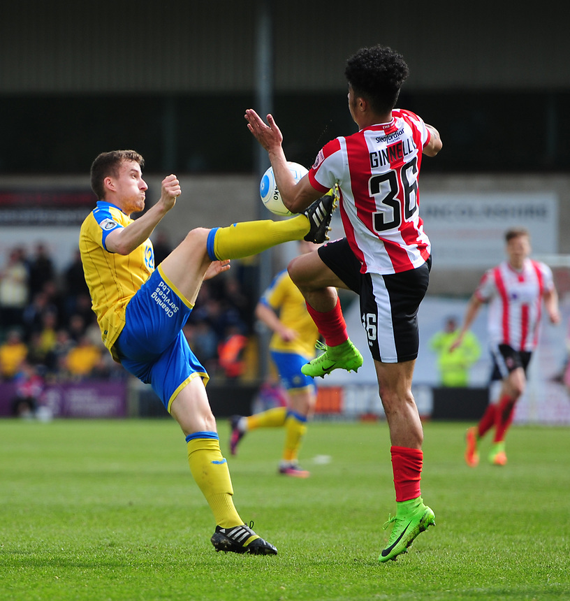 Torquay United's Luke Young vies for possession with Lincoln City's Josh Ginnelly<br /> <br /> Photographer Chris Vaughan/CameraSport<br /> <br /> Vanarama National League - Lincoln City v Torquay United - Friday 14th April 2016  - Sincil Bank - Lincoln<br /> <br /> World Copyright &copy; 2017 CameraSport. All rights reserved. 43 Linden Ave. Countesthorpe. Leicester. England. LE8 5PG - Tel: +44 (0) 116 277 4147 - admin@camerasport.com - www.camerasport.com