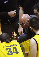 Taranaki coach Angelo Hill talks to his team during the National basketball league match between the Wellington Saints  and Taranaki Mountainairs at TSB Bank Arena, Wellington, New Zealand on Friday, 9 April 2010. Photo: Dave Lintott / lintottphoto.co.nz