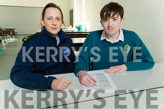 Gda Grace Quirke from the Tralee Garda station, helping Mercy Mounthawk student Danny Sheehy complete his form for the Register of Electors in Mercy Mounthawk on Monday.
