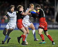 Tom Homer of Bath Rugby is double-tackled by Jackson Wray and Duncan Taylor of Saracens. Aviva Premiership match, between Saracens and Bath Rugby on January 30, 2016 at Allianz Park in London, England. Photo by: Patrick Khachfe / Onside Images
