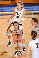 16 October 2010:  FIU's Andrea Lakovic (1) and Marija Prsa (10) celebrate winning a point in the fourth set as the Western Kentucky Hilltoppers defeated the FIU Golden Panthers, 3-2 (25-19, 23-25, 25-20, 25-27, 15-13), at the U.S Century Bank Arena in Miami, Florida.