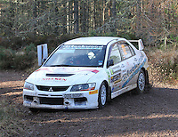 Andrew Gallacher - Phil Sandham in a Mitsubishi Evolution 9 competing at Junction 6 on the Munro Scotch Beef Millbuie Special Stage 1 on the 2014 Arnold Clark/Thistle Hotel Snowman Rally, supported by Highland Office Equipment, part of Capital Document Solutions which was organised by Highland Car Club and based in Inverness on 22.2.14; Round 1 of the 2014 RAC MSA Scottish Rally Championship sponsored by ARR Craib Transport Limited.
