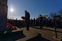 Pictured: A man lays a wreath at the Cenotaph in Swansea, Wales, UK. Sunday 10 November 2019<br /> Re: Remembrance SUnday, a service to commemorate those who lost their lives in conflict has been held at the Cenotaph in Swansea, Wales, UK.