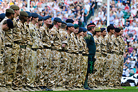 Military servicemen and women line up prior to the match kicking off. Guinness Premiership match, dubbed the St. George's Day Game, between London Wasps and Bath on April 24, 2010 at Twickenham Stadium in London, England. [Mandatory Credit: Patrick Khachfe/Onside Images]