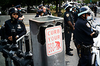 NEW YORK, NEW YORK - June 25: NYPD officers block the entrance of Brooklyn Bridge as people get ready to march as others take part in a protest encampment near NYC City hall on June 25, 2020 in New York, NY. Demonstrators are calling for $1 billion in cuts of NYPD, as they protest encampment near City Hall and NYPD headquarters ahead of the city July 1 budget deadline.  (Photo by Eduardo MunozAlvarez/VIEWpress)