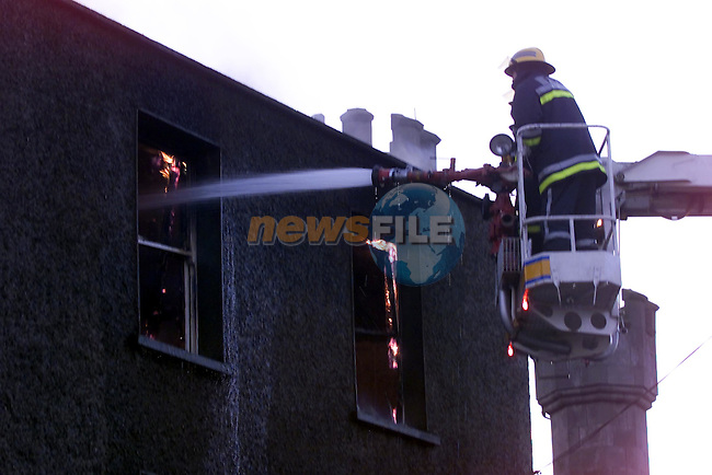 Fireman tackle the flames of the fire from the Hydrolic platform..Picture Fran Caffrey Newsfile.