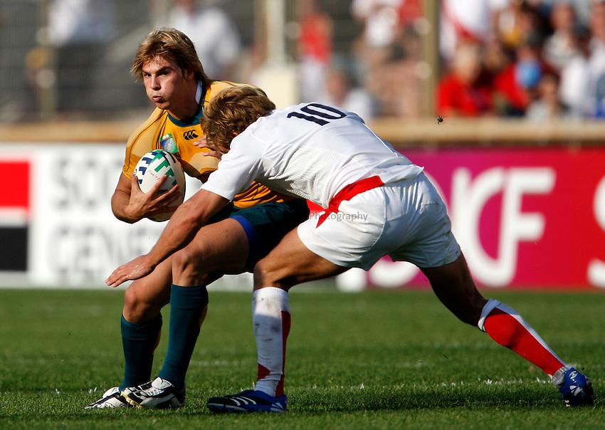 Photo: Richard Lane/Richard Lane Photography..Australia v England. Quarter Final, IRB Rugby World Cup, RWC 2007. 06/10/2007. .Australia's Drew Michel runs at England's Jonny Wilkinson.