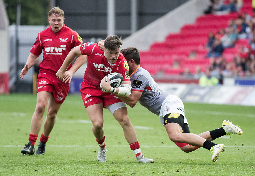 Scarlets' Steffan Evans is tackled by Southern Kings' Jacques Nel<br /> <br /> Photographer Simon King/CameraSport<br /> <br /> Guinness Pro14 Round 1 - Scarlets v Southern Kings - Saturday 2nd September 2017 - Parc y Scarlets - Llanelli, Wales<br /> <br /> World Copyright &copy; 2017 CameraSport. All rights reserved. 43 Linden Ave. Countesthorpe. Leicester. England. LE8 5PG - Tel: +44 (0) 116 277 4147 - admin@camerasport.com - www.camerasport.com
