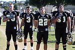 Palos Verdes, CA 10/30/09 - Mitch Seymour (#75), Anthony Papadakis (#22), Ryan Pierson (#3) and Robby Ahumada (#61) pause for the national anthem before the game against Mira Costa.