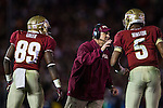 Seminole head coach Jimbo Fisher discusses the final play with quarterback Jameis Winston and wide receiver Christian Green in the BCS national title game at the Rose Bowl in Pasadena, California on January 6, 2014.  Florida State Seminoles defeated the Auburn Tigers 34-31.
