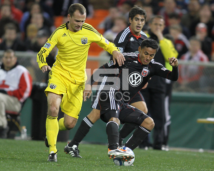 Andy Najar#14 of D.C. United turns the ball away from Rich Balchan#2 of the Columbus Crew during the opening match of the 2011 season at RFK Stadium, in Washington D.C. on March 19 2011.D.C. United won 3-1.