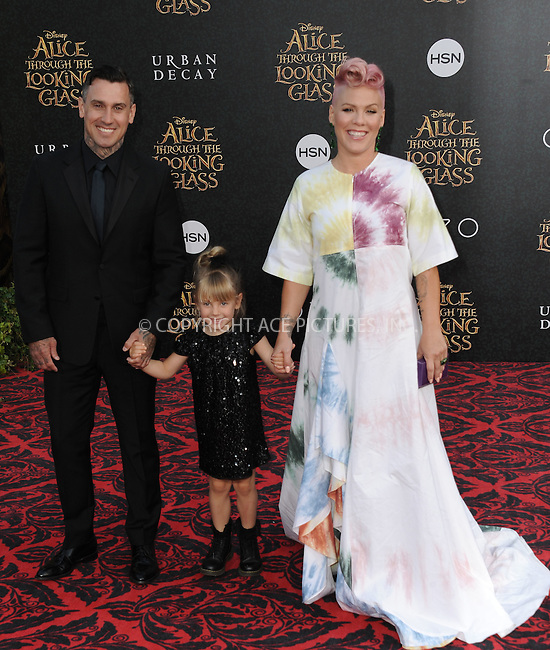 WWW.ACEPIXS.COM<br /> <br /> May 23 2016, LA<br /> <br /> Motorcycle Racer Carey Hart, daughter Willow Sage Hart and Recording Artist Pink, aka Alecia Moore arriving at the premiere of Disney's 'Alice Through The Looking Glass' at the El Capitan Theatre on May 23, 2016 in Hollywood, California.<br /> <br /> <br /> By Line: Peter West/ACE Pictures<br /> <br /> <br /> ACE Pictures, Inc.<br /> tel: 646 769 0430<br /> Email: info@acepixs.com<br /> www.acepixs.com