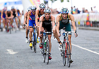 25 JUL 2010 - LONDON, GBR - Stuart Hayes (right) leads a breakaway pack on the bike at the mens race of the London round of the ITU World Championship Series triathlon .(PHOTO (C) NIGEL FARROW)