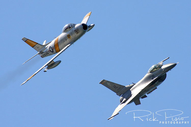 United States Air Force Heritage Flight featuring a Korean War era F-86 Sabre flies in formation with a F-16 Fighting Falcon during San Francisco's 2008 Fleet Week activities.