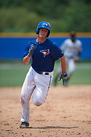 GCL Blue Jays catcher Hagen Danner (33) rounds third to score the game tying run in the bottom of the eighth inning during a game against the GCL Pirates on July 20, 2017 at Bobby Mattick Training Center at Englebert Complex in Dunedin, Florida.  GCL Pirates defeated the GCL Blue Jays 11-6 in eleven innings.  (Mike Janes/Four Seam Images)