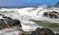 High tide waves crash and pour over rocky outcroppings at Cape Perpetua, Oregon