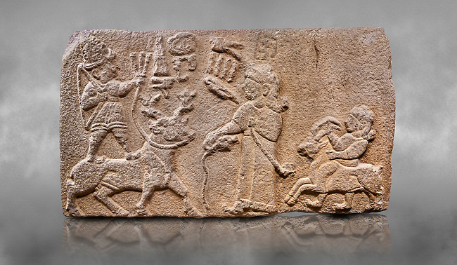 "Aslantepe Hittite relief sculpted orthostat stone panel. Limestone, Aslantepe, Malatya, 1200-700 B.C. Anatolian Civilisations Museum, Ankara, Turkey.<br /> <br /> Scene of king's offering drink and sacrifice to the god. The god is on the deer, with the bow attached to his shoulder and with a triple bundle of lightning in his hand. The king looks at the god, and makes the libation to the god while carrying a scepter with a curled end - lituus. Behind the king is a servant holding a goat for sacrifice to the god. Hieroglyphs read; ""God Parata, Strong King... "". <br /> <br /> Against a grey art background."