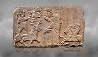 Aslantepe Hittite relief sculpted orthostat stone panel. Limestone, Aslantepe, Malatya, 1200-700 B.C. Anatolian Civilisations Museum, Ankara, Turkey.<br /> <br /> Scene of king's offering drink and sacrifice to the god. The god is on the deer, with the bow attached to his shoulder and with a triple bundle of lightning in his hand. The king looks at the god, and makes the libation to the god while carrying a scepter with a curled end - lituus. Behind the king is a servant holding a goat for sacrifice to the god. Hieroglyphs read; &quot;God Parata, Strong King... &quot;. <br /> <br /> Against a grey art background.