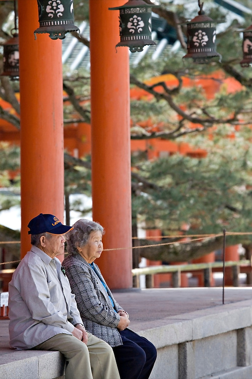 Couple sitting together at Heian-Jingu Shrine in Kyoto Japan