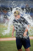 Batavia Muckdogs water balloon on field promotion during a game against the West Virginia Black Bears on August 21, 2016 at Dwyer Stadium in Batavia, New York.  West Virginia defeated Batavia 6-5. (Mike Janes/Four Seam Images)