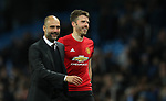 Manchester City Manager Pep Guardiola and Michael Carrick of Manchester United after the English Premier League match at The Etihad Stadium, Manchester. Picture date: April 27th, 2016. Photo credit should read: Lynne Cameron/Sportimage