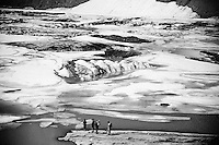 Tourists walk up to the melting ice of Grinnell Glacier in Glacier National Park, Montana, USA.  Though the Park had more than 150 glaciers in 1850, the 26 remaining are expected to melt away by 2030.