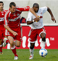 Chicago Fire forward Nate Jaqua (11) and New York Red Bulls defender Marvell Wynne (2) battle for the ball.  The Chicago Fire defeated the New York Red Bulls 2-1 at Toyota Park in Bridgeview, IL on September 3, 2006..