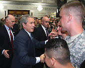 President George W. Bush greets soldiers, airmen, sailors and Marines to say 'Thank you' to deployed troops at Al Faw Palace in Camp Victory in Baghdad, Iraq, Sunday, December 14, 2008. Bush thanked the troops for their service and wished them happy holidays in his final visit as the President of the United States..Credit: Benjamin Crane - U.S. Army via CNP