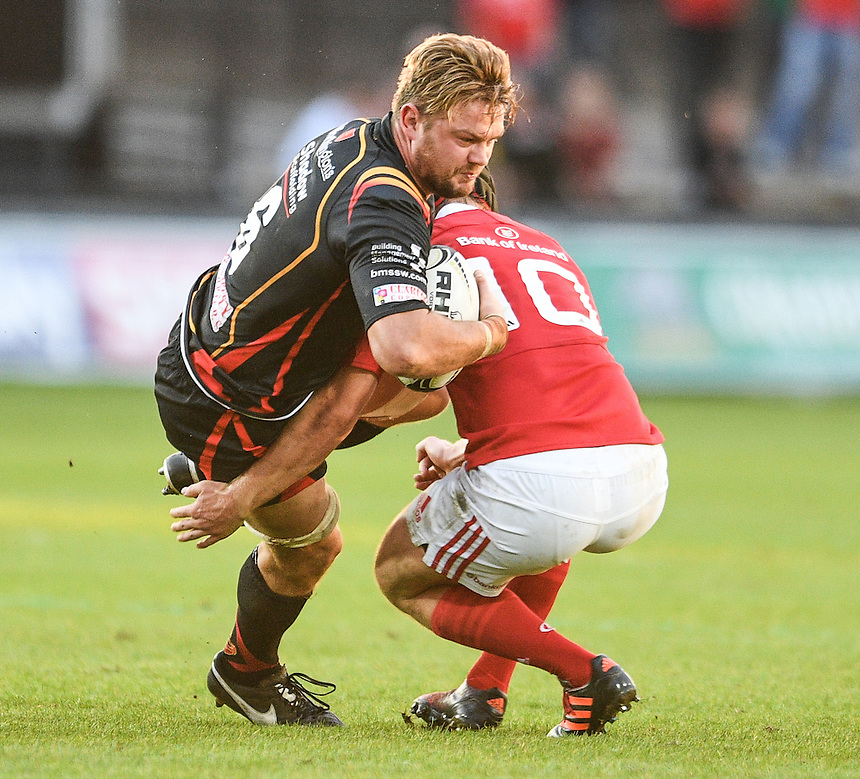 Lewis Evans of Dragons is tackled by Tyler Bleyendaal of Munster<br /> <br /> Photographer Craig Thomas/CameraSport<br /> <br /> Guinness PRO12 Round 3 - Newport Gwent Dragons v Munster Rugby - Saturday 17 September 2016 - Rodney Parade - Newport<br /> <br /> World Copyright &copy; 2016 CameraSport. All rights reserved. 43 Linden Ave. Countesthorpe. Leicester. England. LE8 5PG - Tel: +44 (0) 116 277 4147 - admin@camerasport.com - www.camerasport.com
