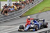 1st October 2017, Sepang, Malaysia;  FIA Formula One World Championship, Grand Prix of Malaysia; Pascal Wehrlein with Sebastian Vettel (GER 5), Scuderia Ferrari