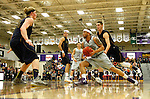 SIOUX FALLS, SD - JANUARY 2:  Freddie Young #23 from the University of Sioux Falls drives against Daniel Jansen #34 and Adam Beyer #11 from Augustana in the first half of their game Friday night at the Stewart Center. (Photo by Dave Eggen/Inertia)