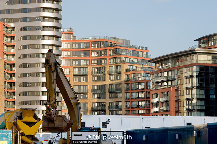 Construction work on Merchant Square at Paddington Basin, in front of the completed West End Quay development.