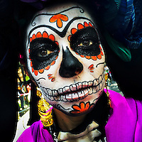A young girl, representing a Mexican cultural icon called La Catrina, takes a part in celebrations of the Day of the Dead (Día de Muertos) in Mexico City, Mexico, 29 October 2016.
