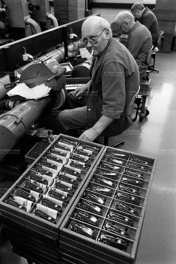 Switzerland. Canton Jura. Delémont. Wenger factory. Swiss army knife's production. Workers at work. © 1992 Didier Ruef