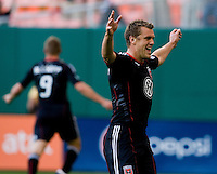 Adam Christman (7) of D.C. United celebrates a goal by teammate Danny Allsopp (9) at RFK Stadium in Washington, DC.  D.C. United defeated the Kansas City Wizards, 2-1.