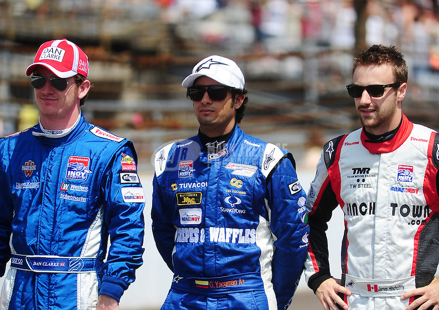 May 28, 2010; Indianapolis, IN, USA; Indy Light Series drivers Dan Clarke (left), Gustavo Yacaman (center) and James Hinchcliffe during the Freedom 100 at the Indianapolis Motor Speedway. Mandatory Credit: Mark J. Rebilas-