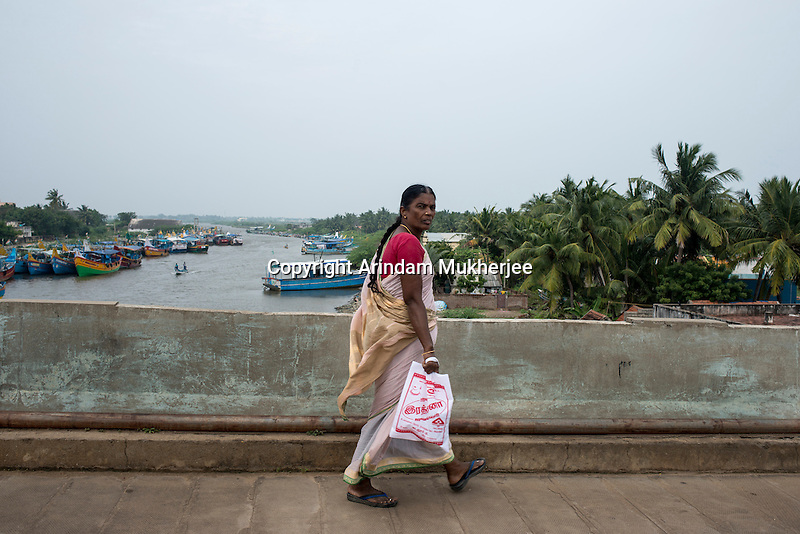 A lady passes by the bridge near Sonankuppam at Cuddalore. This is the area where Indra used to live before Tsunami. Tamil Nadu, India.