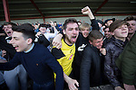 Visiting fans in the away end celebrating with midfielder Ian McFarland after East Stirlingshire took on Edinburgh City in the second leg of the Scottish League pyramid play-off at Ochilview Park, Stenhousemuir. The play-offs were introduced in 2015 with the winners of the Highland and Lowland Leagues playing-off for the chance to play the club which finished bottom of Scottish League 2. Edinburgh City won the match 1-0 giving them a 2-1 aggregate victory making them the first club in Scottish League history to be promoted into the league.