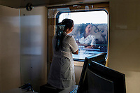 Carina Sadirdinova, the nurse and receptionist on the Matvei Mudrov, stands at the window of the train after a day's work, looking outside. <br /> <br /> The Matvei Mudrov train is a medical train operated by Russian Railways along the course of the Baikal Amur Magistral (Baikal-Amur Mainline, or BAM) railway line. Named after a famous 19th century Russian physician, the train employs around 15 doctors who make about 10 trips a year, each lasting two weeks. Along the way they deliver essential medical services to people living in remote villages along the 4,324 km long BAM railway. Though not equipped to carry out surgical procedures the train has heart monitors, ultrasound and x-ray machines to deliver diagnosis.