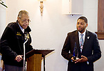 WATERBURY, CT-011518JS03---Waterbury Veteran Samuel Beamon thanks everyone being honored with the Dr. Martin Luther King Community Service award from Pastor Kirstopher S. Reese, right, during the Waterbury Fellowship of Christian Churches' annual Martin Lither King Jr. Day Service held Monday at Grace Baptist Church in Waterbury. <br /> Jim Shannon Republican-American