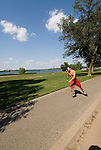 Minnesota, Twin Cities, Minneapolis-Saint Paul: Recreation at the south end of Lake Calhoun.  Man inline skating..Photo mnqual276-74933..Photo copyright Lee Foster, www.fostertravel.com, 510-549-2202, lee@fostertravel.com.